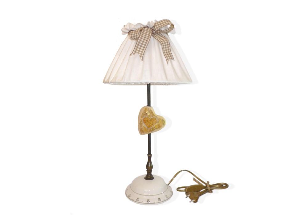 Lampada da tavolo con cuore dorato in ceramica